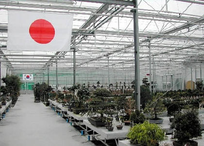 Some national flags of production area are displayed.